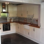 Fully fitted kitchen with Oak work surfaces