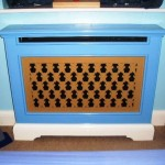 Radiator cover with hand cut grille