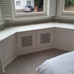 Bespoke window seat incorporating radiator cover