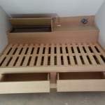 Bespoke childs bed in loft with storage